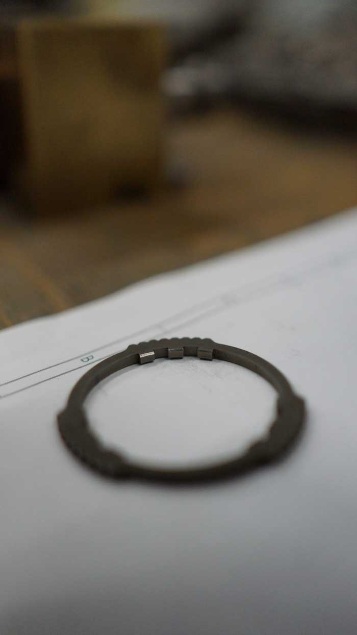 wire eroded washers with internal and external profiling